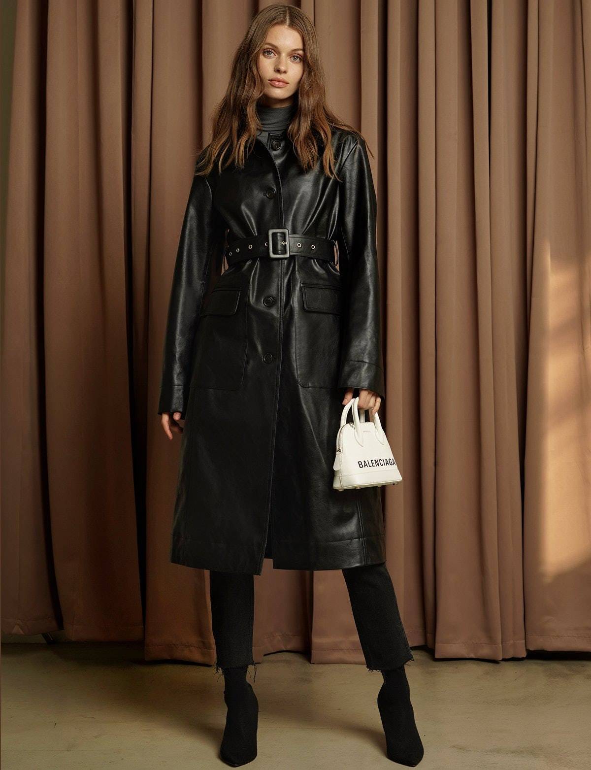 730cbb1eb6b0 The Leather Trench Coat Trend Should Be Your Go-To This Winter