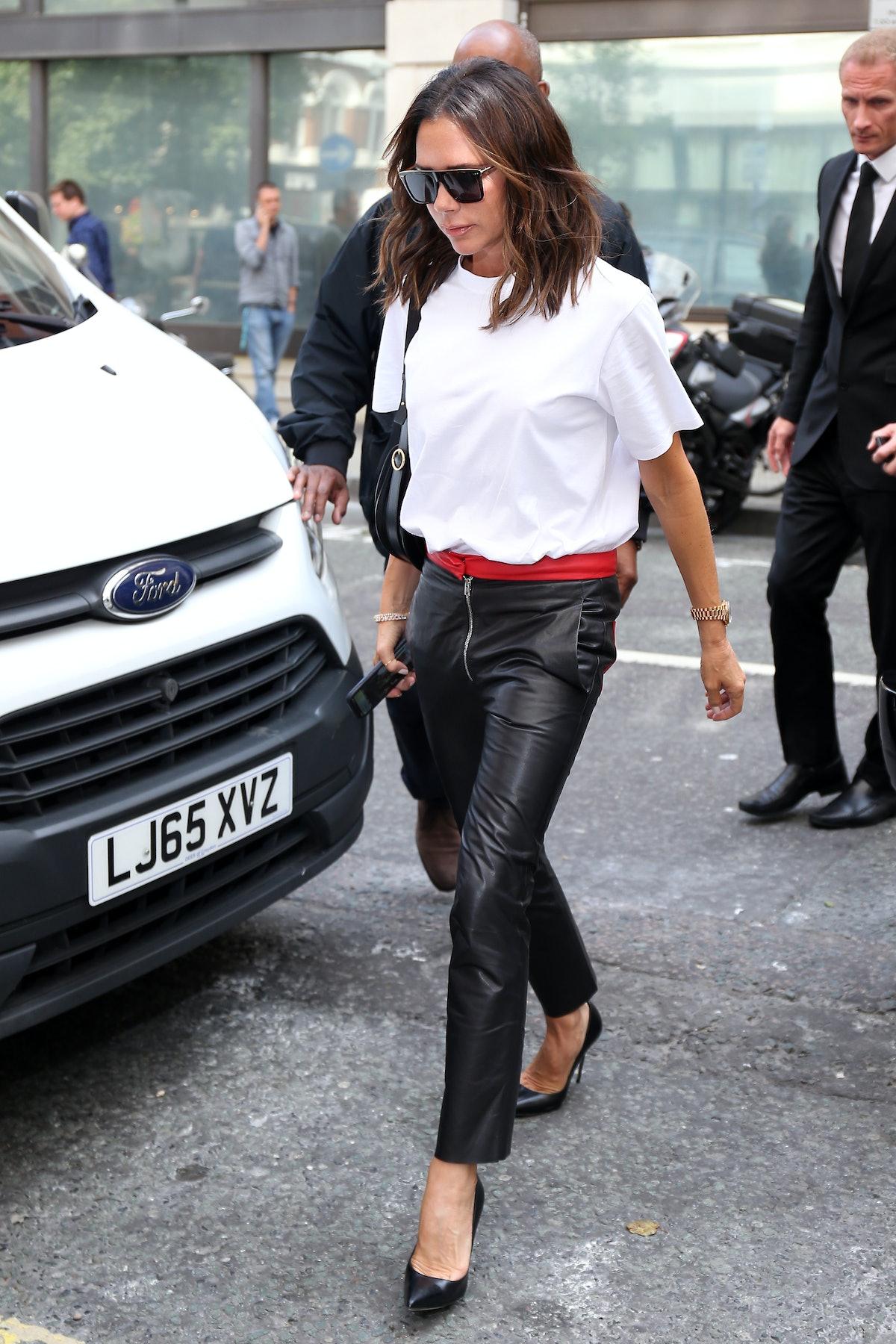 Victoria Beckham in a white tee.