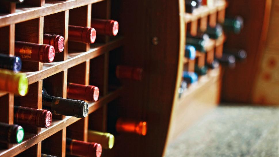 This Wine Cellar Hidden In A Kitchen Island Is The Fantasy ...
