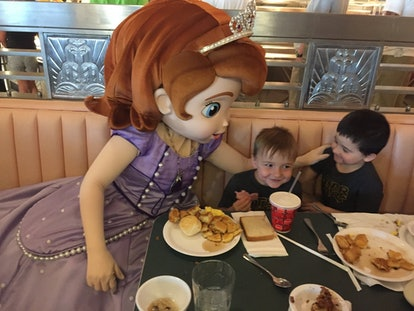Princess Sophia says hello during a Character meal at the park.