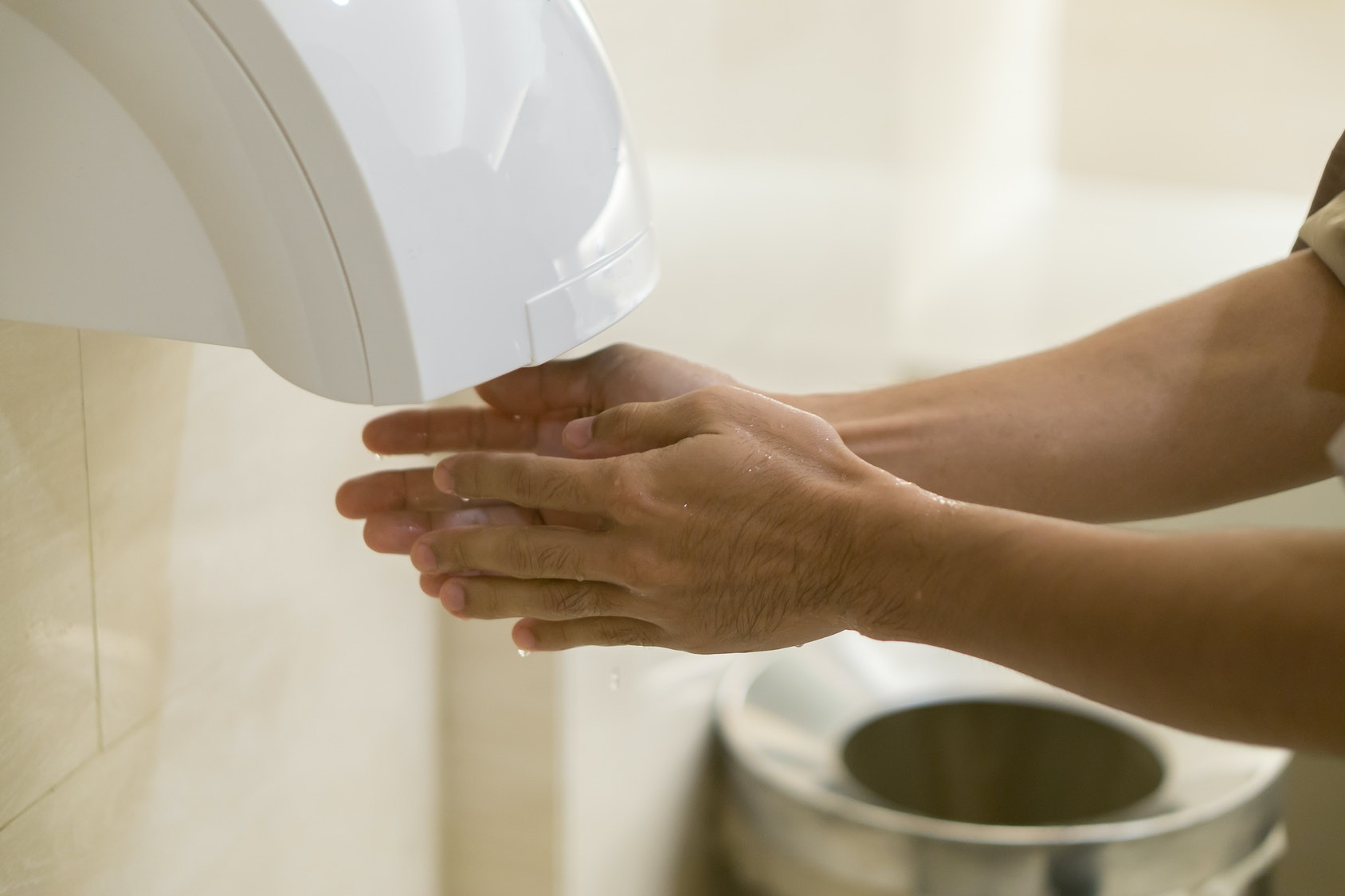 Are Bathroom Hand Dryers Sanitary? A New Study Found They May Spray You  With More Bacteria Than Youu0027d Think