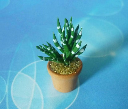This faux cactus is technically created for use in dollhouses and models, but who says you can't model it in YOUR house? It is handmade of ceramic and clay in Bangkok, Thailand.