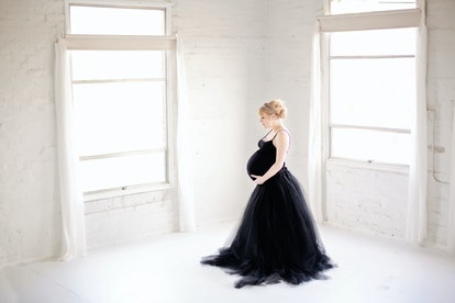 Burke 34 weeks pregnant with twins as a surrogate. Photo courtesy of Brea Bursch Photographer