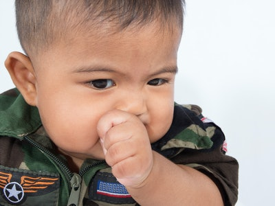 Teething is just one of many reasons why babies put their hands in their mouths.