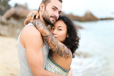 Woman on beach realizes partner doesn't love her as much as she loves him.