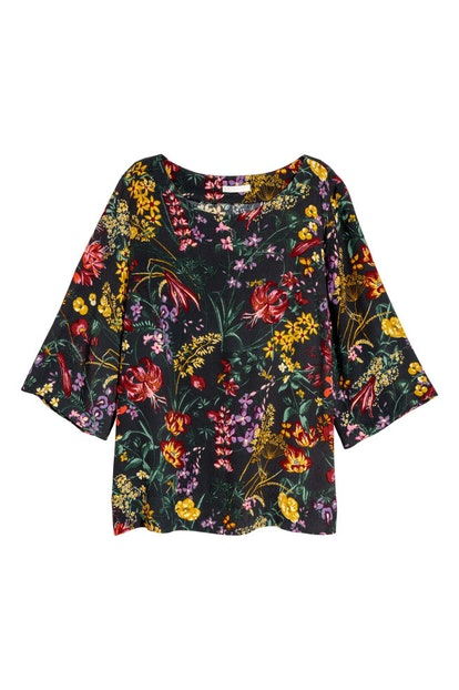That is a whole lot of print for not a whole lot of dollars, my friend. The top is originally $10, but is being slashed by 60 percent for the holiday. This is one tee that will add a little funkiness into any outfit, and there's no better time to add it to your closet than right now.