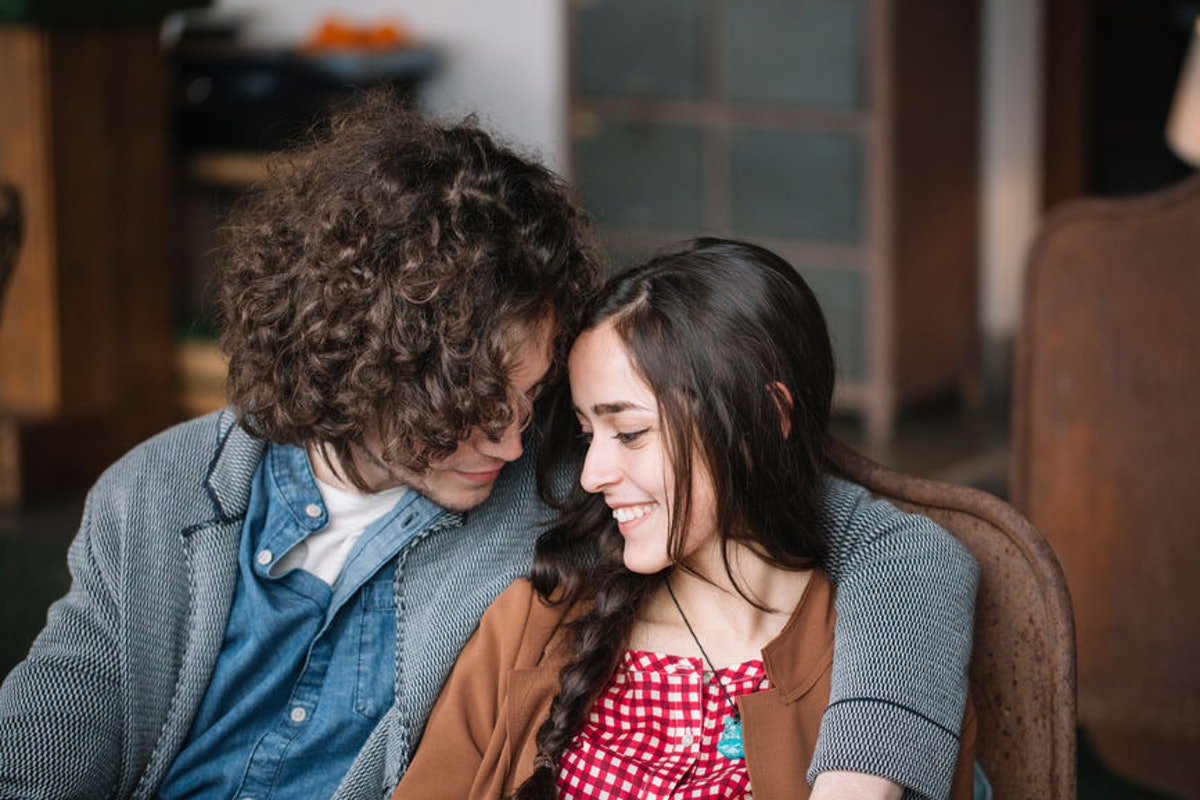 How To Tell If Your Partner's High-Key In Love With You, According To Experts