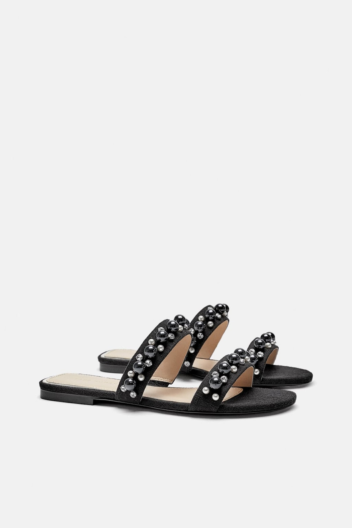 FLAT SANDALS WITH PEARL STRAPS