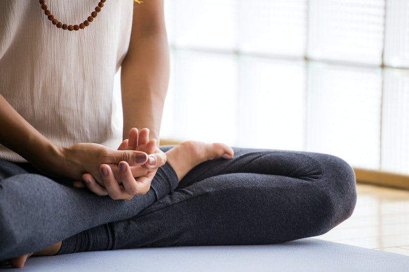 Woman meditating to boost her mood