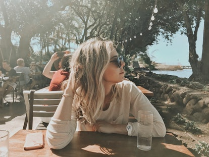 Writer Sara Altschule sits at a table in the sun. Here's what she did after finding out she was BRCA Positive.
