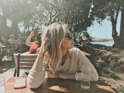 Writer Sara Altschule sits at a table in the sun. Here's what she did after finding out she was BRCA...