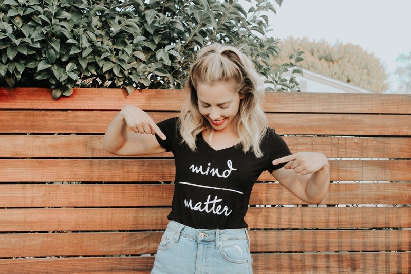 """The writer points to her tshirt with the slogan """"mind over matter."""" Here's what one writer did after her BRCA 2 diagnosis."""