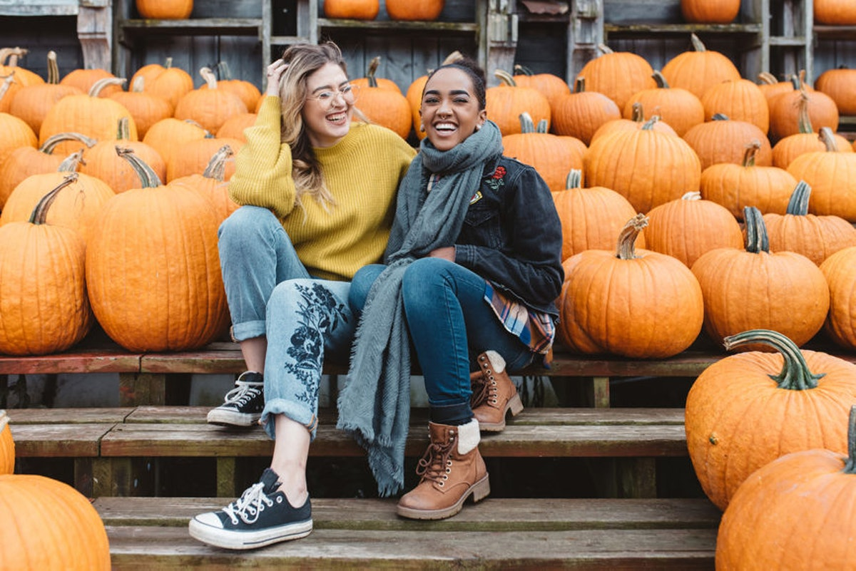 Two girls laughing candidly surrounded by pumpkins is the perfect picture pose to pair with pumpkin ...