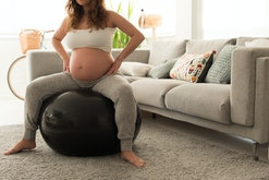 woman in labor on exercise ball