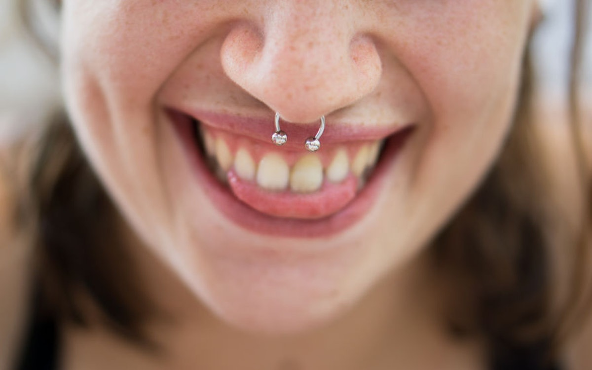 What Do Dreams About Your Teeth Falling Out Mean? It's All About Communication, Experts Say