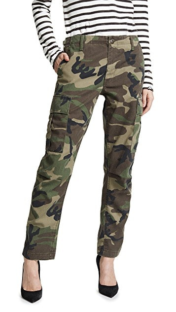 bce4f389109a3 Why 2019's Camouflage Trend Is Achievable, No Matter How You'd Describe  Your Style