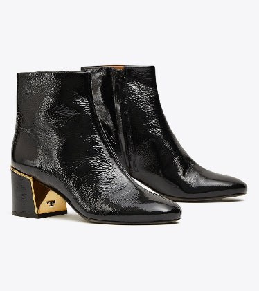 ad9d87c67 Tory Burch s Semi-Annual Sale Includes The Most Classic Leather Boots   A  Chic Snakeskin Purse
