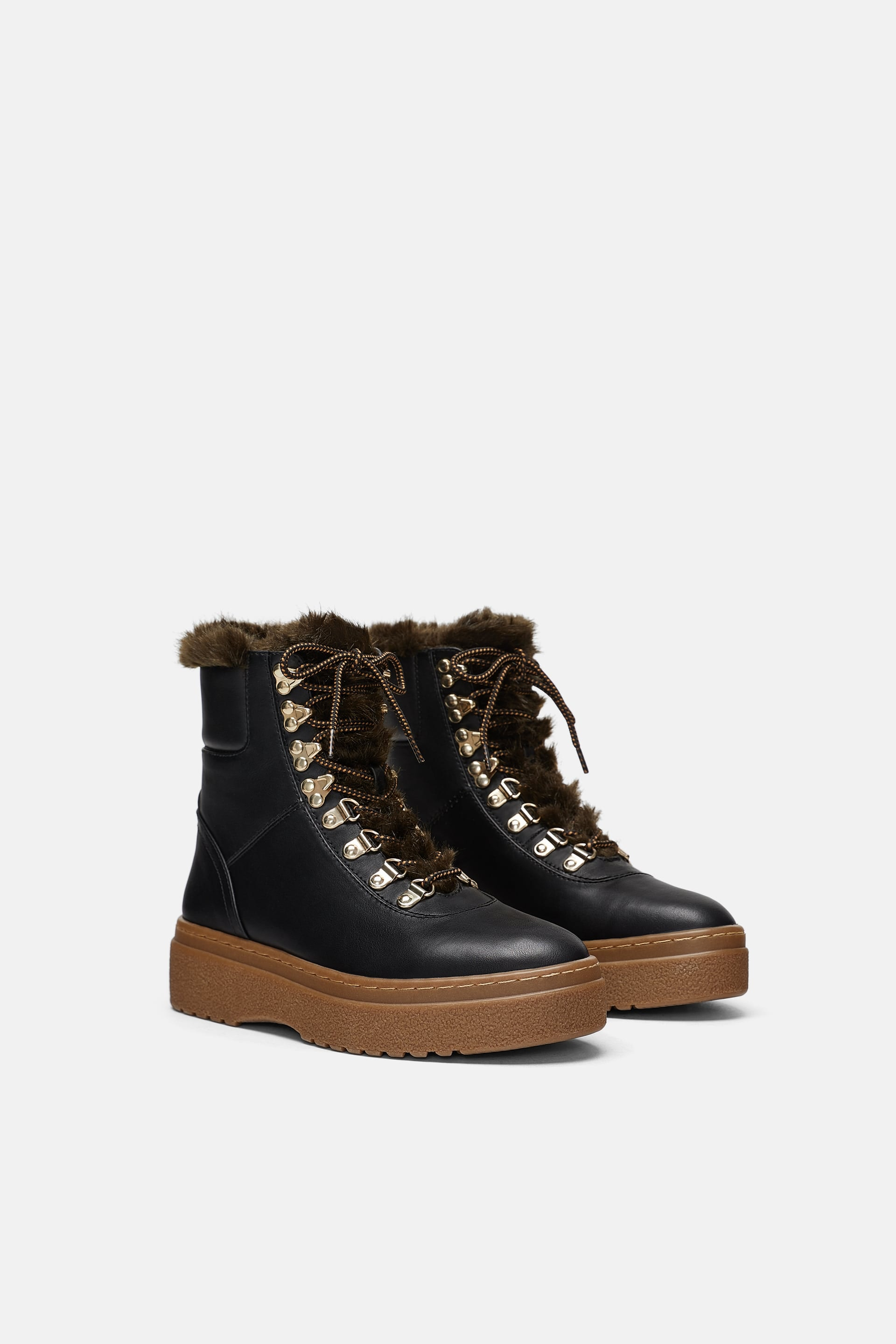 10 Flat Winter Boots Under $100 To Snag