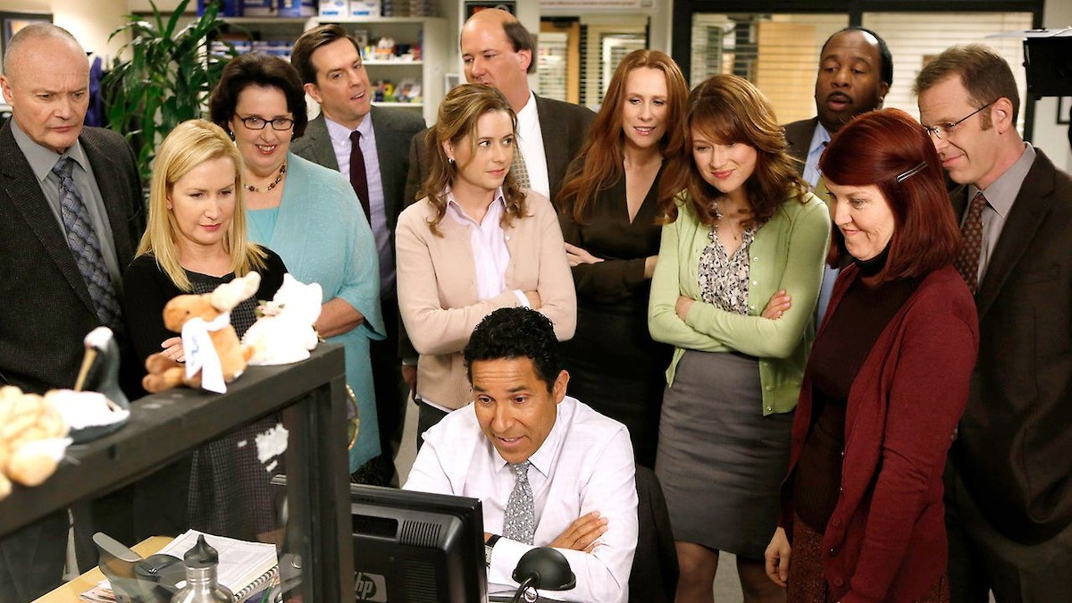 'The Office' cast looking at Oscar's computer, in need of Instagram captions.