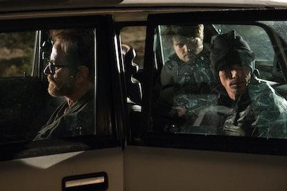 Bryan Cranston as Walter White, Charles Baker as Skinny Pete, and Matt Jones as Badger in a car in t...
