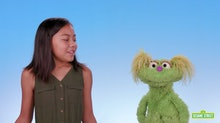 10-year-old Salia Woodbury and Karli the muppet in a 'Sesame Street' video about addiction.