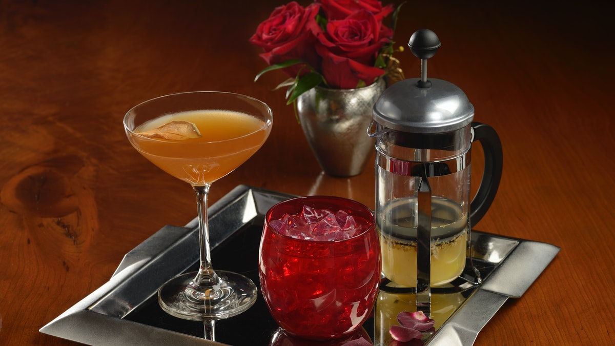"""A tray of cocktails is served on a platter at Disney's Enchanted Rose lounge that's inspired by 'Beauty and the Beast."""""""