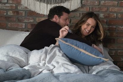 Newly married couple Jo, played by Camilla Luddington, and Alex joke around in bed.