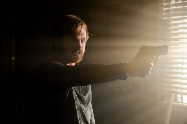 Aaron Paul as Jesse Pinkman holding a gun in the Breaking Bad finale