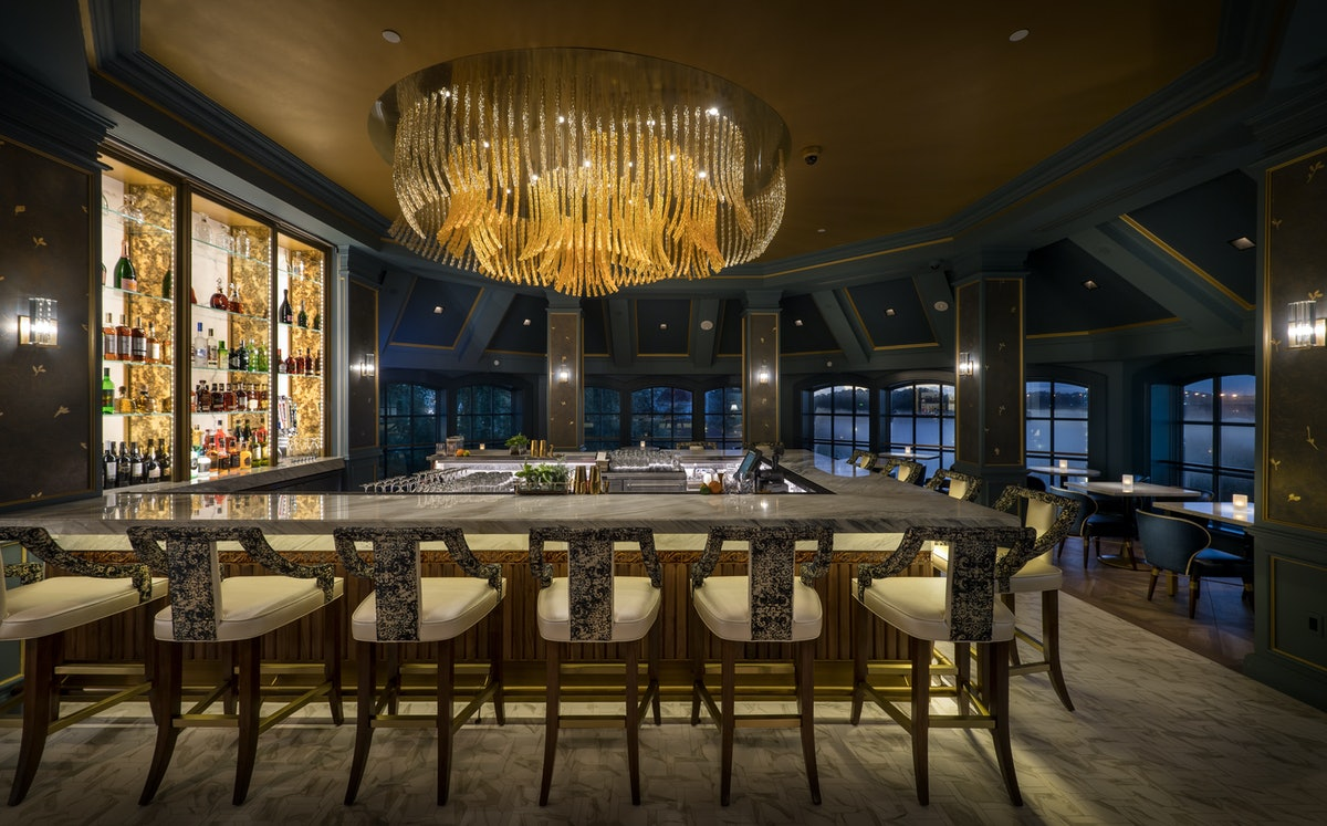 The main bar at Disney's Enchanted Rose lounge at Disney World is inspired by 'Beauty and the Beast.'