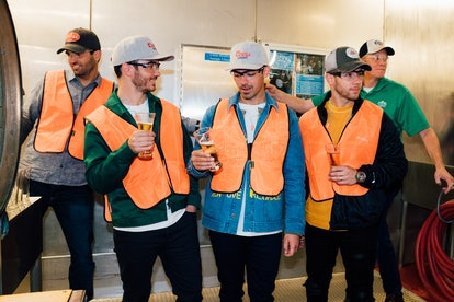 Kevin, Nick, and Joe Jonas visited the Coors brewery during their Happiness Begins tour.