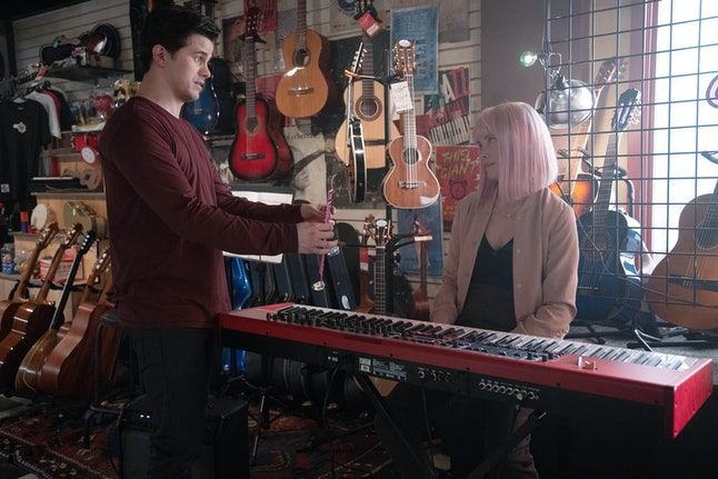 Jason Ritter as Eric and Allison Miller as Maggie on A Million Little Things sitting in a music shop.