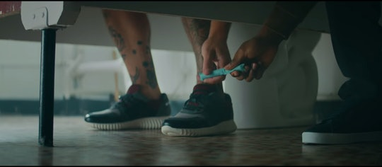 Man passes tampon under bathroom stall in new Thinx ad.