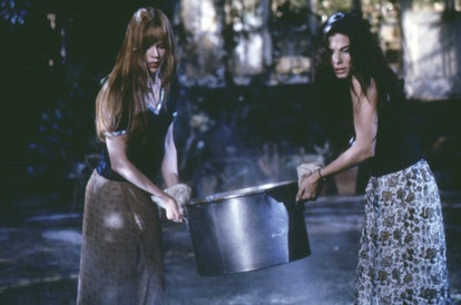 Nicole Kidman and Sandra Bullock carry a cauldron in a scene from the 1998 movie Practical Magic.