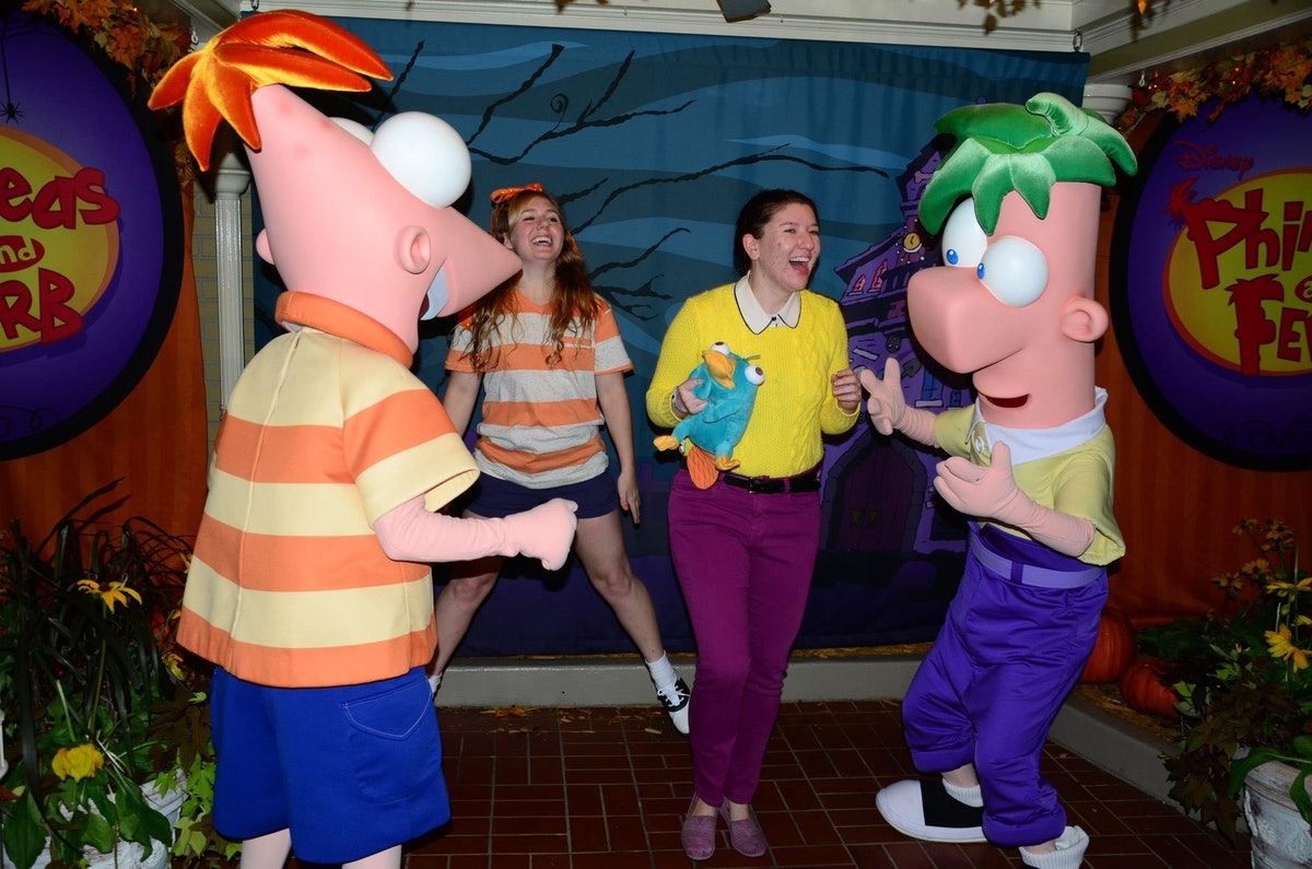 Two friends dressed like 'Phineas and Ferb' would need Disney costume captions for pictures they take on Halloween.