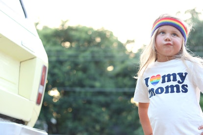 "The author's 4-year-old daughter, wearing a rainbow headband and a t-shirt that says ""I love my moms."""