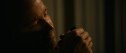 Aaron Paul as Jesse Pinkman looking at beetle in 'El Camino: A Breaking Bad Movie'