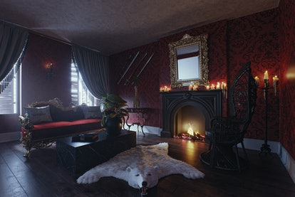 A look inside the Addam's Family home living room, which is available to rent on Booking.com.