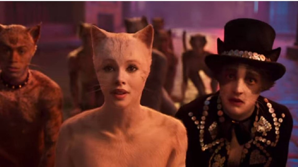 three cat characters stand side by side in still from Cats the movie