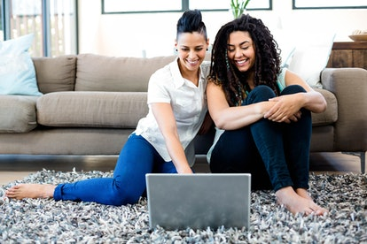 A couple looks over financial information at a laptop. A 401(k) is not the only way to save for retirement in your 20s.