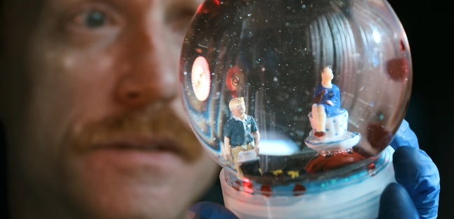 """A snow globe depicting Todd and Lydia at a café in """"El Camino: A Breaking Bad Movie'"""