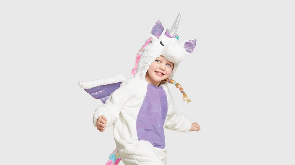 a little girl wearing a unicorn costume from target