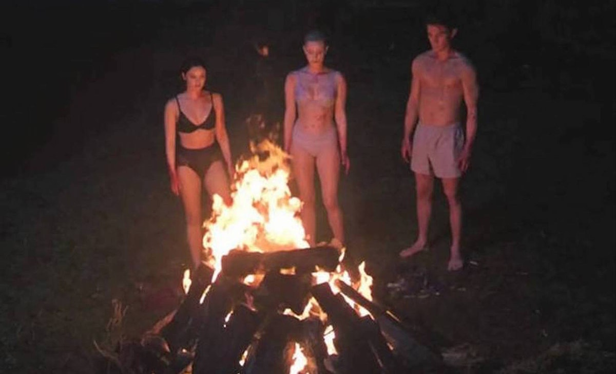 Archie, Betty, and Veronica around a fire in the 'Riverdale' Season 3 finale