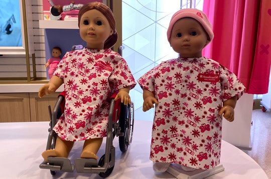 American Girl dolls at hospital in NYC in hospital gowns and wheelchair