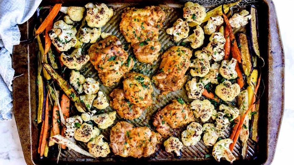 tandoori chicken with vegetables on a sheet pan
