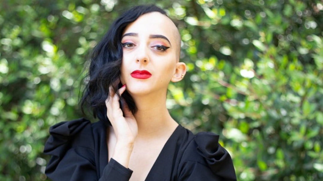 Gabriela Herstik, the author of 'Inner Witch,' poses in a black dress.
