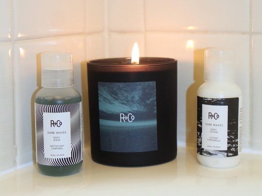 R+Co's new DARK WAVES Body Wash and Lotion with candle
