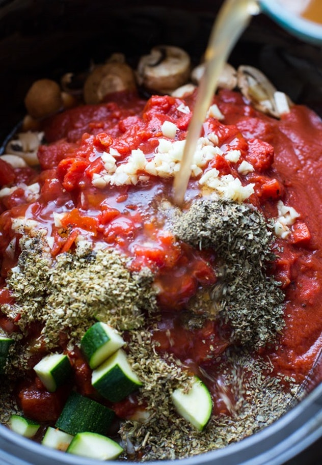 zucchini, onion, tomato sauce, and spices in slow cooker