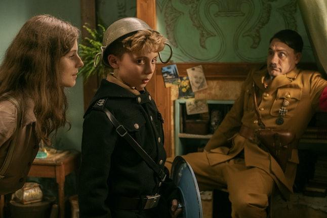 Thomasin McKenzie as Elsa, Roman Griffin Davis as Jojo, and Taika Waititi as Hitler in Jojo Rabbit