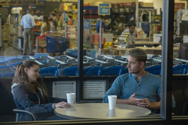 Cassidy and Kevin having coffee together at a store on This Is Us.