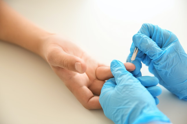 A person gets blood taken for an STI test